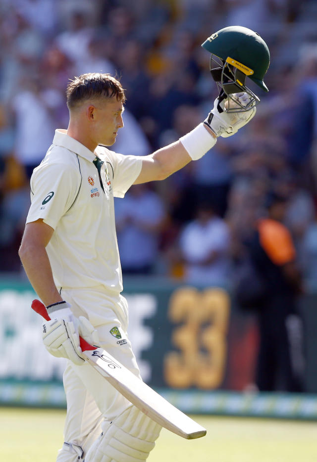 Australia's Marnus Labuschagne walks off the field after he lost his wicket for 185 runs during their cricket test match against Pakistan in Brisbane, Australia, Saturday, Nov. 23, 2019. (AP Photo/Tertius Pickard)