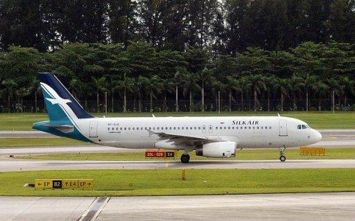 A SilkAir plane prepares for take-off at Changi International Airport in Singapore