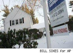 sale pending sign white house in snow