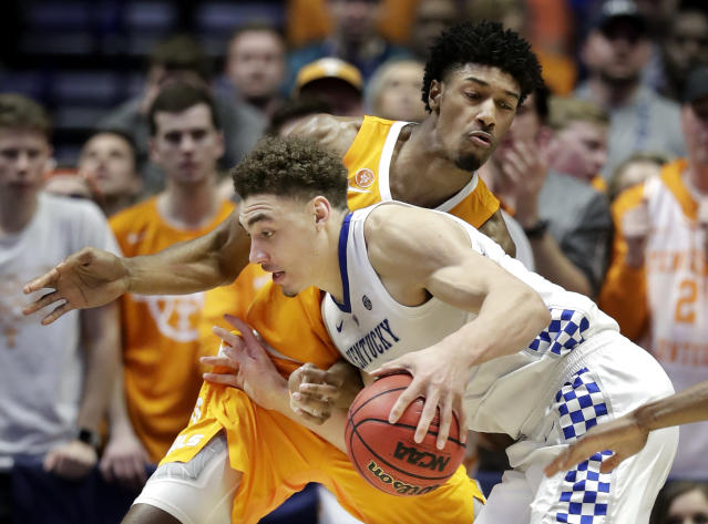 Kentucky forward Reid Travis, front, drives against Tennessee forward Kyle Alexander in the first half of an NCAA college basketball game at the Southeastern Conference tournament Saturday, March 16, 2019, in Nashville, Tenn. (AP Photo/Mark Humphrey)