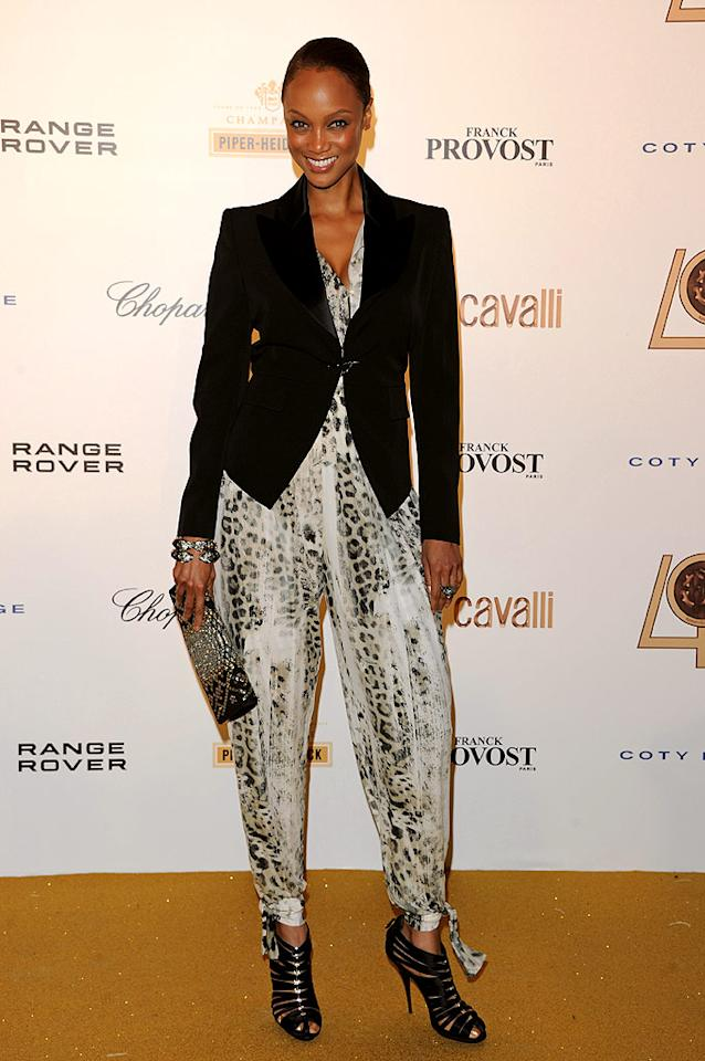 """Tyra Banks makes her second consecutive appearance in """"What Were They Thinking?!"""" thanks to the ludicrous leopard-print jumpsuit she unsuccessfully attempted to rock at Roberto Cavalli's 40th anniversary party in Paris. Venturelli/<a href=""""http://www.wireimage.com"""" target=""""new"""">WireImage.com</a> - September 29, 2010"""