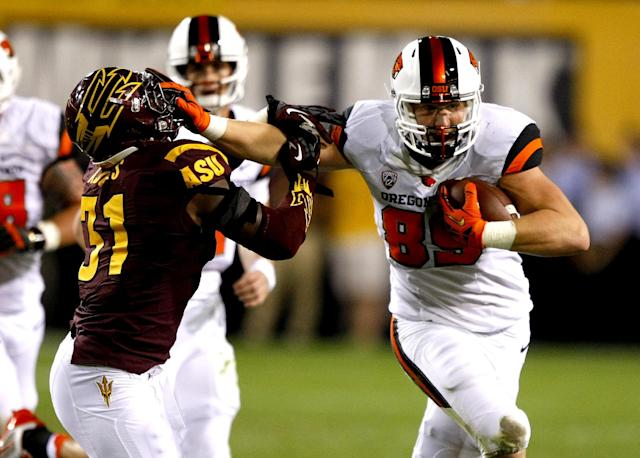 Oregon State tight end Connor Hamlett (89) stiff arms Arizona State linebacker Anthony Jones (31) during the first half of an NCAA college football game on Saturday, Nov. 16, 2013, in Tempe, Ariz. (AP Photo/Rick Scuteri)