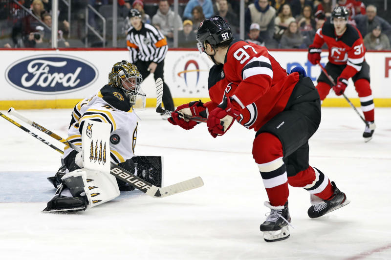 Boston Bruins goaltender Jaroslav Halak (41) blocks a shot by New Jersey Devils left wing Nikita Gusev (97) during the second period of an NHL hockey game, Tuesday, Dec. 31, 2019, in Newark, N.J. (AP Photo/Kathy Willens)