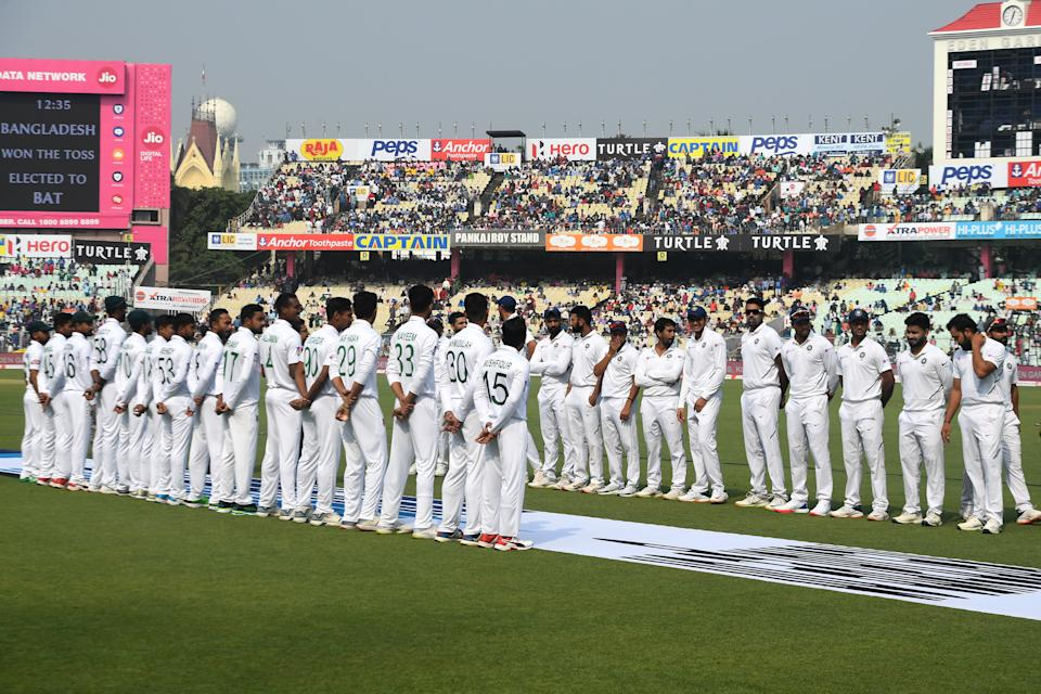 Bangladesh's and Indian cricket players wait to meet the Bangladesh's Prime Minister Sheikh Hasina before the start of the first day of the second Test cricket match of a two-match series between India and Bangladesh at The Eden Gardens cricket stadium in Kolkata on November 22, 2019. (Photo by Dibyangshu SARKAR / AFP) / IMAGE RESTRICTED TO EDITORIAL USE - STRICTLY NO COMMERCIAL USE
