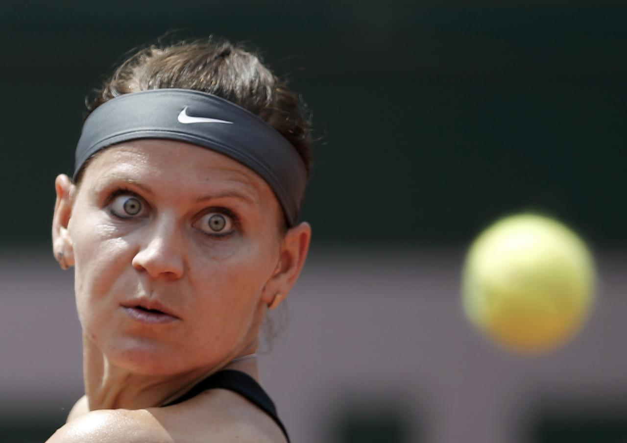 Lucie Safarova of the Czech Republic eyes the ball during her women's singles match against Ana Ivanovic of Serbia at the French Open tennis tournament at the Roland Garros stadium in Paris May 31, 2014. REUTERS/Stephane Mahe (FRANCE - Tags: SPORT TENNIS)