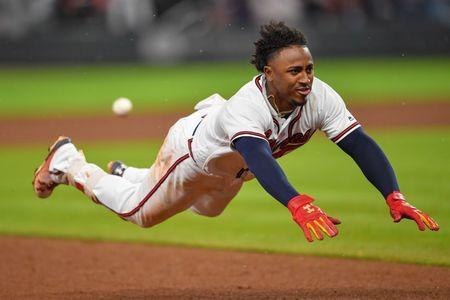 May 16, 2018; Atlanta, GA, USA; Atlanta Braves second baseman Ozzie Albies (1) dives into third base after hitting a triple against the Chicago Cubs during the eighth inning at SunTrust Park. Mandatory Credit: Dale Zanine-USA TODAY Sports