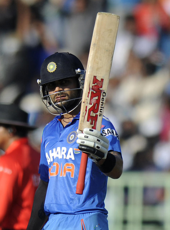 Virat Kholi of India celebrates after scoring a half century during the second Star Sports One Day International (ODI) match between India and The West Indies held at the Dr. Y.S. Rajasekhara Reddy ACA-VDCA Cricket Stadium, Vishakhapatnam, India on the 24th November 2013  Photo by: Pal Pillai - BCCI - SPORTZPICS   Use of this image is subject to the terms and conditions as outlined by the BCCI. These terms can be found by following this link:  https://ec.yimg.com/ec?url=http%3a%2f%2fsportzpics.photoshelter.com%2fgallery%2fBCCI-Image-Terms%2fG0000ahUVIIEBQ84%2fC0000whs75.ajndY&t=1506209943&sig=3NPZZpwEIQvwuKl7klxySQ--~D