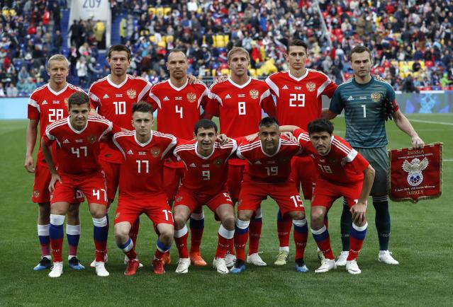 Russia's team players pose prior the friendly soccer match between Russia and Turkey at the VEB Arena stadium in Moscow, Russia, Tuesday, June 5, 2018. (AP Photo/Pavel Golovkin)