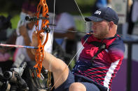 Matt Stutzman of the U.S. holds the bow with his foot as he competes in the Archery men's individual compound-open event at the Tokyo 2020 Paralympic Games, Friday, Aug. 27, 2021, in Tokyo, Japan. (AP Photo/Shuji Kajiyama)