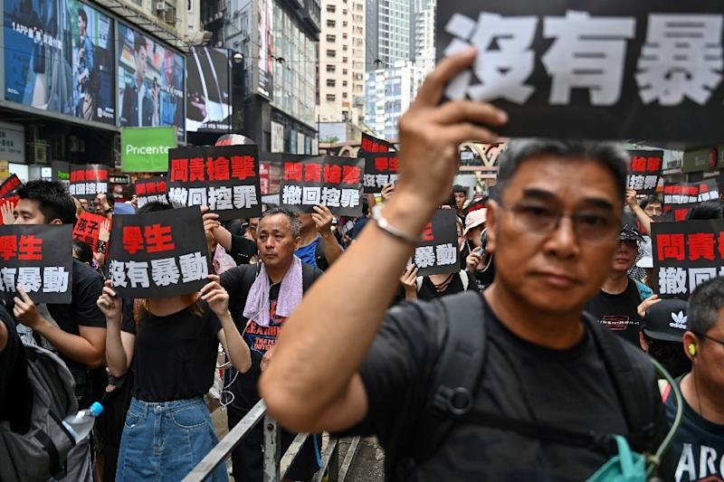 Protesters chanted 'Scrap the evil law!' as they marched through the streets to pile more pressure on Hong Kong chief executive Carrie Lam (AFP Photo/Hector RETAMAL)