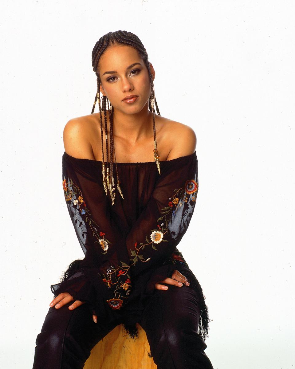"""It would just be too perfect if Alicia Keys's last name really was Keys, considering she so beautifully plays the piano. But no, her real name is actually Alicia Augello Cooke. At first she thought of Wild for a last name to use professionally, but her mom objected. She later <a href=""""https://www.cleveland19.com/story/7347199/keys-mom-stopped-her-from-picking-stage-name-that-sounded-like-a-stripper/"""" rel=""""nofollow noopener"""" target=""""_blank"""" data-ylk=""""slk:decided"""" class=""""link rapid-noclick-resp"""">decided</a> on Keys since it just made sense: """"It's like the piano keys."""""""