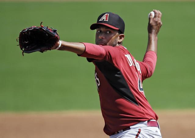 Arizona Diamondbacks starting pitcher Randall Delgado pitches against the Cincinnati Reds in the first inning of a spring exhibition baseball game Thursday, March 27, 2014, in Goodyear, Ariz. (AP Photo/Mark Duncan)