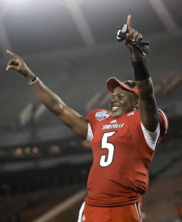 Louisville quarterback Teddy Bridgewater points to cheering fans after Louisville defeated Miami 36-9 in the Russell Athletic Bowl NCAA college football game in Orlando, Fla., Saturday, Dec. 28, 2013. (AP Photo/John Raoux)