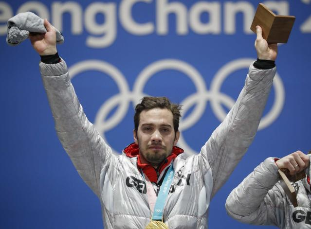 Medals Ceremony - Luge - Pyeongchang 2018 Winter Olympics - Men's Doubles - Medals Plaza - Pyeongchang, South Korea - February 16, 2018 - Gold medalist Tobias Wendl of Germany on the podium. REUTERS/Kim Hong-Ji