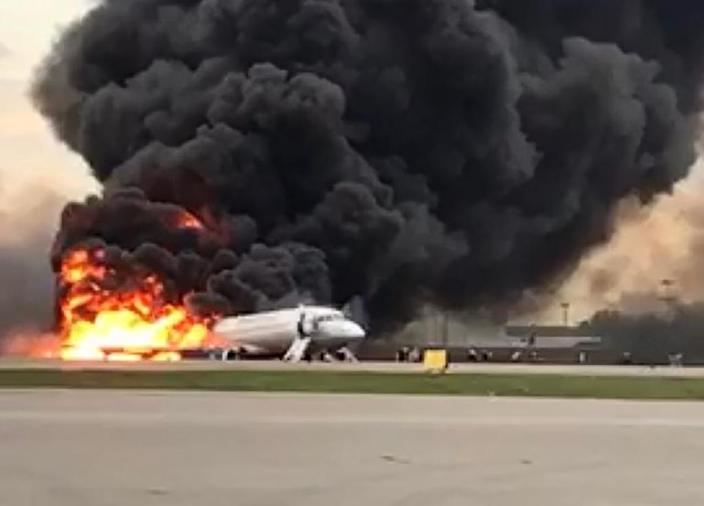 Flames and thick smoke were pouring from the aircraft as it landed (AFP Photo/HO)