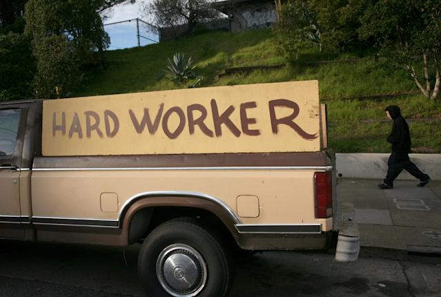 "A handmade sign painted on the side of a pickup truck reading ""hard worker"" is shown in San Francisco, California, January 25, 2009. California's unemployment rate jumped to 9.3 percent in December, a 14-year high for the state and significantly higher than the month's national average of 7.2 percent. REUTERS/Robert Galbraith (UNITED STATES)"