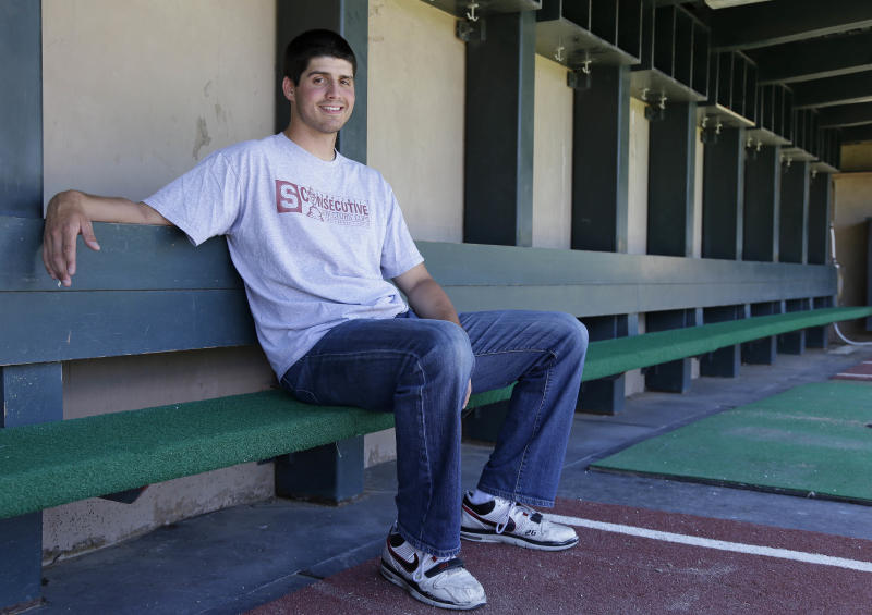 FILE - In this May 20, 2013 photo, Stanford pitcher Mark Appel poses in the dugout of the Sunken Diamond in Stanford, Calif. The Houston Astros have the top pick in the Major League Baseball draft for the second straight year, with the team considering several players to take No. 1 including a pair of pitchers in Stanford's Appel and Oklahoma's Jonathan Gray and a pair of third basemen in North Carolina's Colin Moran and San Diego's Kris Bryant. (AP Photo/Eric Risberg)