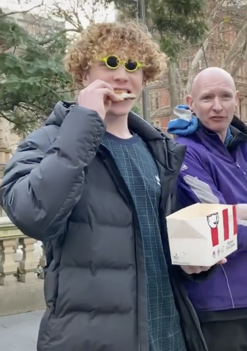 Harry Tate was filmed eating KFC in front of vegan protesters. Source: TikTok/harry.tate