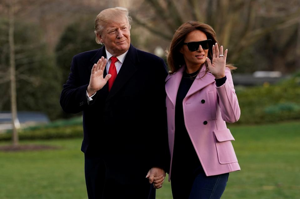 U.S. President Donald Trump and First Lady Melania Trump wave on the South Lawn of the White House upon their return to Washington from West Palm Beach, Florida, U.S., March 31, 2019. REUTERS/Yuri Gripas     TPX IMAGES OF THE DAY