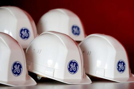 FILE PHOTO: The General Electric logo is pictured on working helmets in Montoir-de-Bretagne
