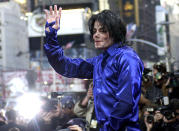 """FILE - In this Nov. 7, 2001 file photo, Michael Jackson waves to crowds gathered to see him at his first ever in-store appearance to celebrate his new album """"Invincible"""" in New York. As the 10th anniversary of Jackson's death approaches, experts say his music legacy is still going strong despite the documentary's detailed abuse allegations. (AP Photo/Suzanne Plunkett, File)"""