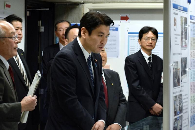 "Yohei Matsumoto (C), parliamentary vice minister in Japan's Cabinet Office, arrives at a ceremony to mark ""Takeshima Day"" in Matsue, Shimane prefecture, on February 22, 2015"