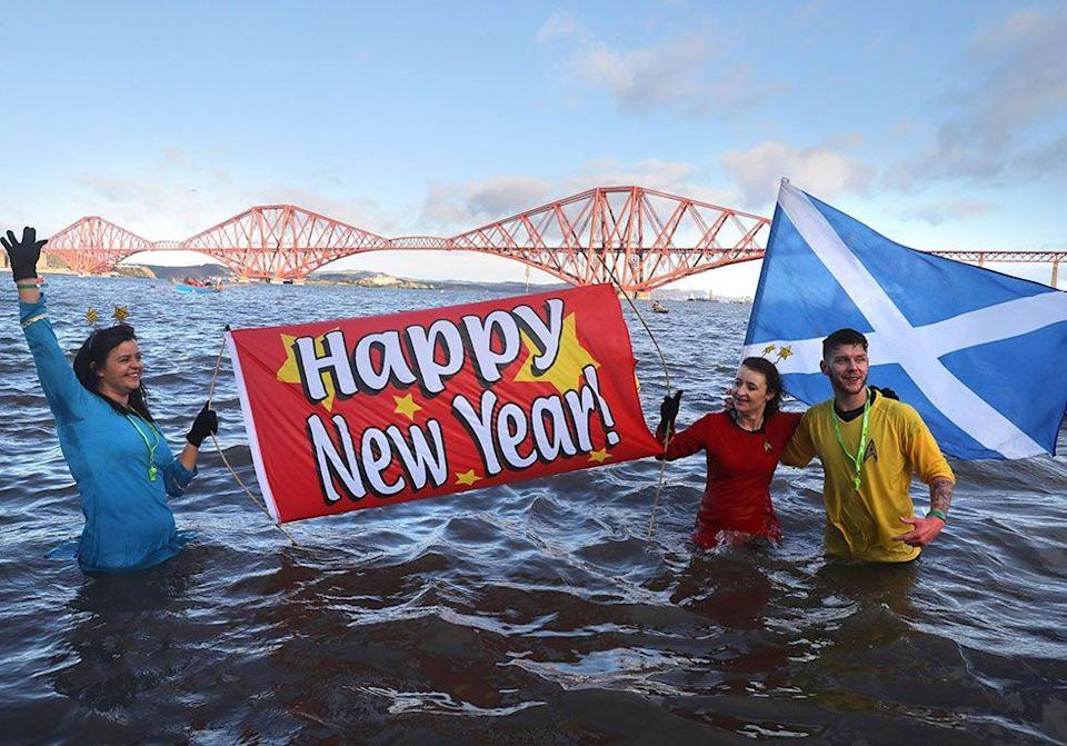 """<p>In Scotland, a celebration called <a href=""""https://www.tripadvisor.com/Attraction_Review-g186525-d8820201-Reviews-Edinburgh_Hogmanay-Edinburgh_Scotland.html"""" rel=""""nofollow noopener"""" target=""""_blank"""" data-ylk=""""slk:Hogmanay"""" class=""""link rapid-noclick-resp"""">Hogmanay</a> takes place, which involves jumping into a freezing river, and swinging fireballs over head. There's also a more comfortable tradition known as """"First Footing,"""" where revelers bring treats to their neighbors after midnight. It's considered good luck if the first person to enter your home is a strapping, dark-haired man with <a href=""""https://www.housebeautiful.com/lifestyle/recipes-cookbooks/a940/american-whiskey-punch-recipe-1112/"""" rel=""""nofollow noopener"""" target=""""_blank"""" data-ylk=""""slk:whiskey to share"""" class=""""link rapid-noclick-resp"""">whiskey to share</a>. This is presumably a nod to the Viking days when it was considered the opposite of lucky if a tall blonde stranger came to your home wielding a sword. </p>"""