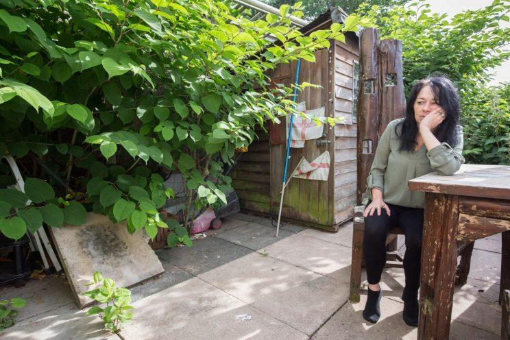 A fed-up Marie Moore in the garden (Caters)