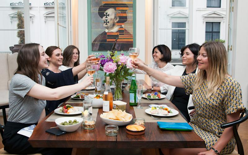 Raising a glass: Helena (far left), writer Anna Hart (far right) with four fellow guests at the AirDine evening - AJ Levy