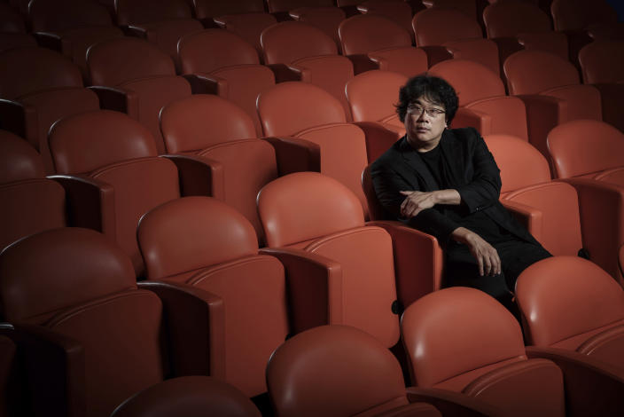 """This Oct. 8, 2019 photo shows filmmaker Bong Joon-Ho posing for a portrait at the Whitby Hotel screening room in New York to promote his film """"Parasite."""" (Photo by Christopher Smith/Invision/AP)"""