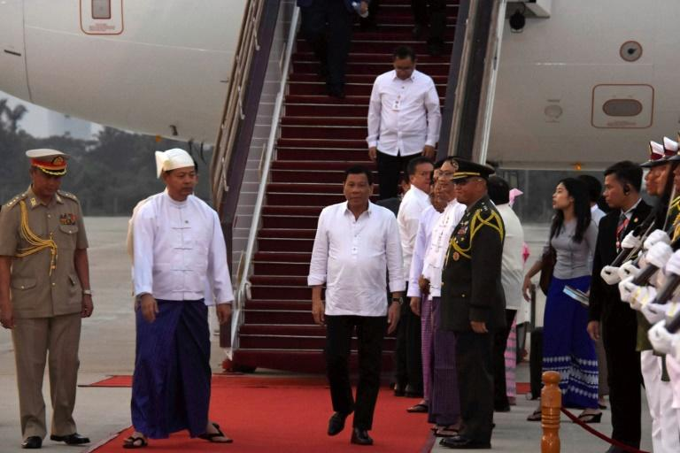 Philippine President Rodrigo Duterte (C) arrives at Naypyidaw International Airport on a four-day official visit to Myanmar and Thailand, on March 19, 2017