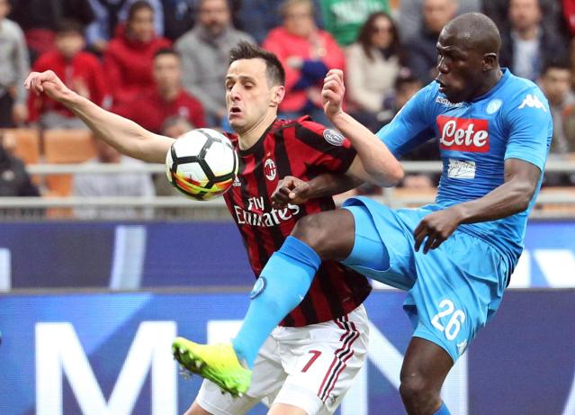 AC Milan's forward Nikola Kalinic and Napoli's defender Kalidou Koulibaly vie for the ball during the Serie A soccer match between Napoli and AC Milan at the Milan San Siro Stadium, Italy, Sunday, April 15, 2018. (Matteo Bazzi/ANSA via AP)