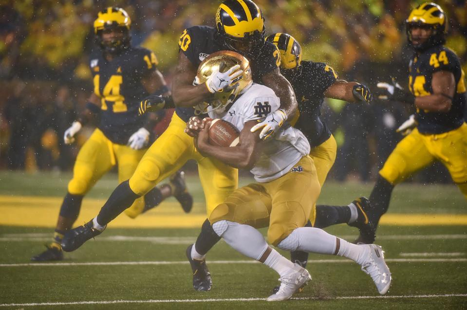 ANN ARBOR, MICHIGAN - OCTOBER 26: Defensive back Brad Hawkins #20 of the Michigan Wolverines tackles a Notre Dame player during a college football game against the Notre Dame Fighting Irish at Michigan Stadium on October 26, 2019 in Ann Arbor, Michigan. (Photo by Aaron J. Thornton/Getty Images)