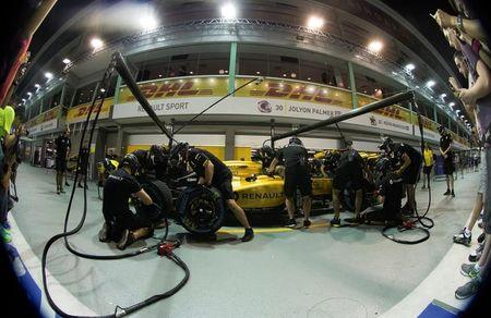 Renault Formula One pit crew practices changing tyres in the pit ahead of the Singapore F1 Grand Prix Night Race in Singapore