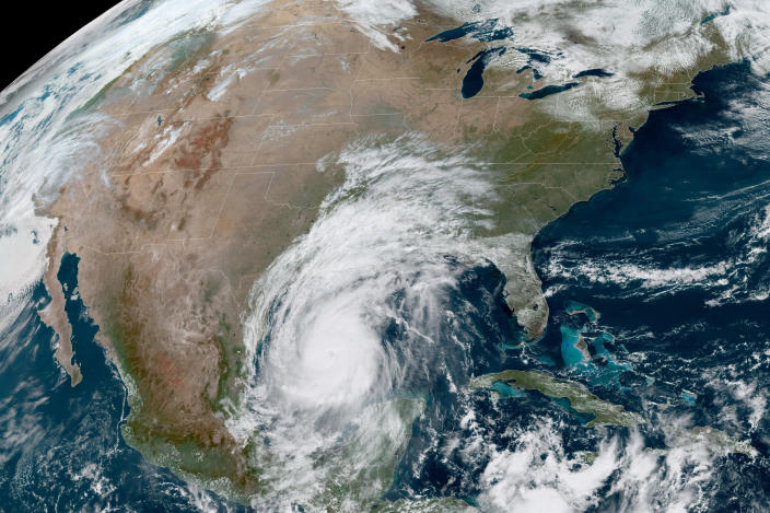 This Oct. 8, 2020 photo made available by the National Oceanic and Atmospheric Administration shows Hurricane Delta in the Gulf of Mexico at 12:41 p.m. EDT. Delta, gaining strength as it bears down on the U.S. Gulf Coast, is the latest and nastiest in a recent flurry of rapidly intensifying Atlantic hurricanes that scientists largely blame on global warming. (NOAA via AP)