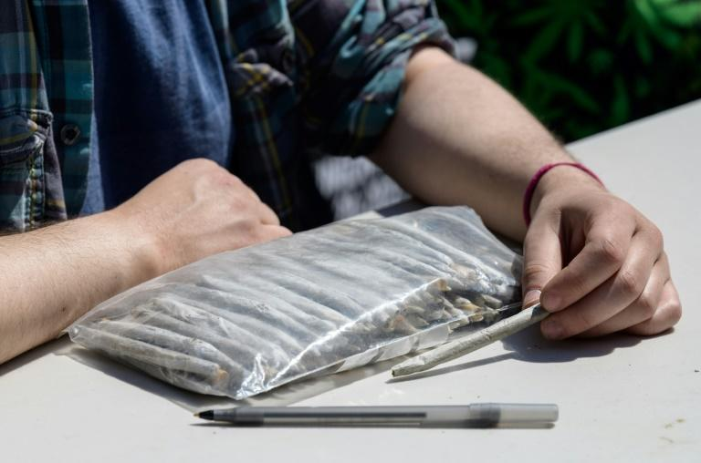 A marijuana activist waits to hand out free joints to vaccinated New Yorkers on April 20, 2021 in New York City