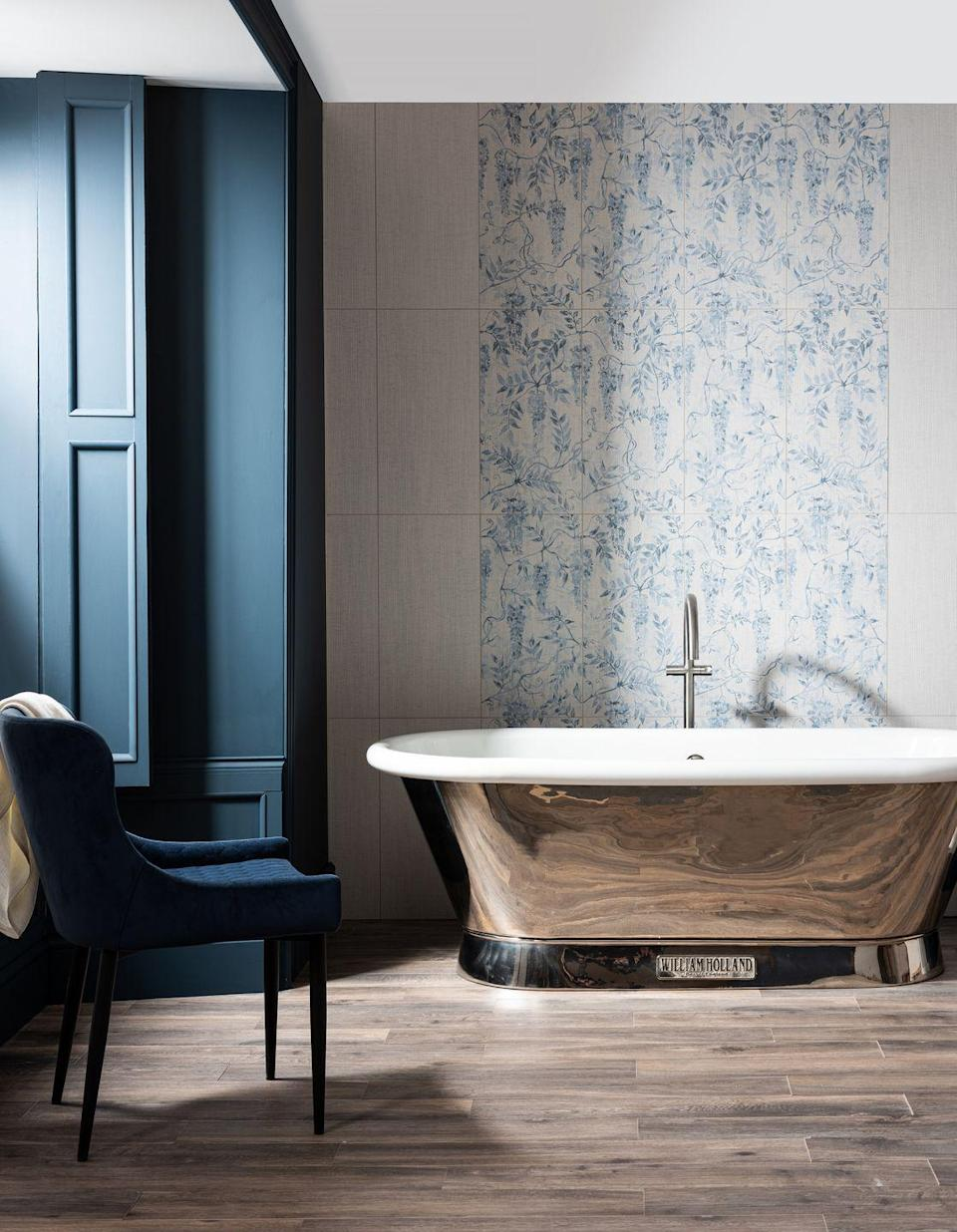 """<p>These pale blue ceramic tiles from Original Style are reminiscent of Delft pottery, adding a touch of visual interest and classic references to an otherwise plain bathroom. Where an entire wall of heavily patterned tiles may be overwhelming, this clever column frames the feature bathtub and offsets the white walls. </p><p>Pictured: <a href=""""https://www.originalstyle.com/tiles/product/CS2302-6030"""" rel=""""nofollow noopener"""" target=""""_blank"""" data-ylk=""""slk:Arbour Ceramic Tiles at Original Style"""" class=""""link rapid-noclick-resp"""">Arbour Ceramic Tiles at Original Style</a></p>"""