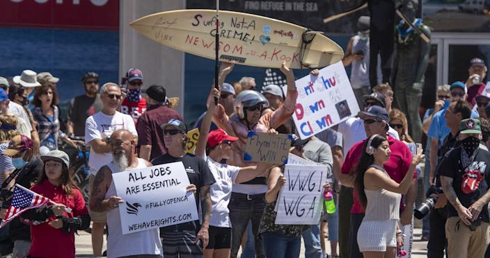 Thousands of protesters rally at Main Street and Pacific Coast Highway in Huntington Beach on May 1.