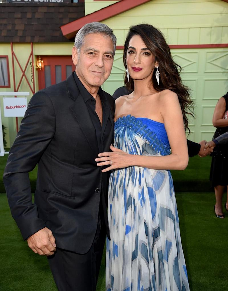 Executive producer/director George Clooney and his wife Amal Clooney arrive at the premiere of Paramount Pictures'