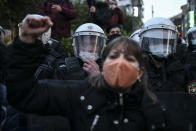 A protester chants slogans in front of police officers in riot gear during a demonstration in Istanbul, Friday, March 26, 2021, against Turkey's withdrawal from Istanbul Convention, an international accord designed to protect women from violence. The Istanbul Convention states that men and women have equal rights and obliges national authorities to prevent gender-based violence against women, but conservative groups and some officials from Turkeys President Recep Tayyip Erdogan's Islamic-oriented ruling party say they promote homosexuality. (AP Photo/Emrah Gurel)