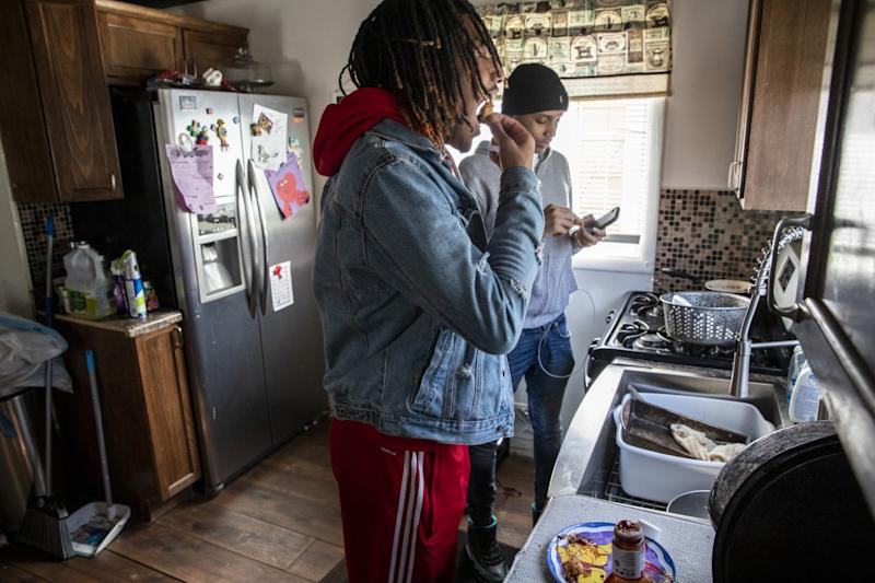 Taevion Rushing eats lunch at home with his cousin, Kyren.
