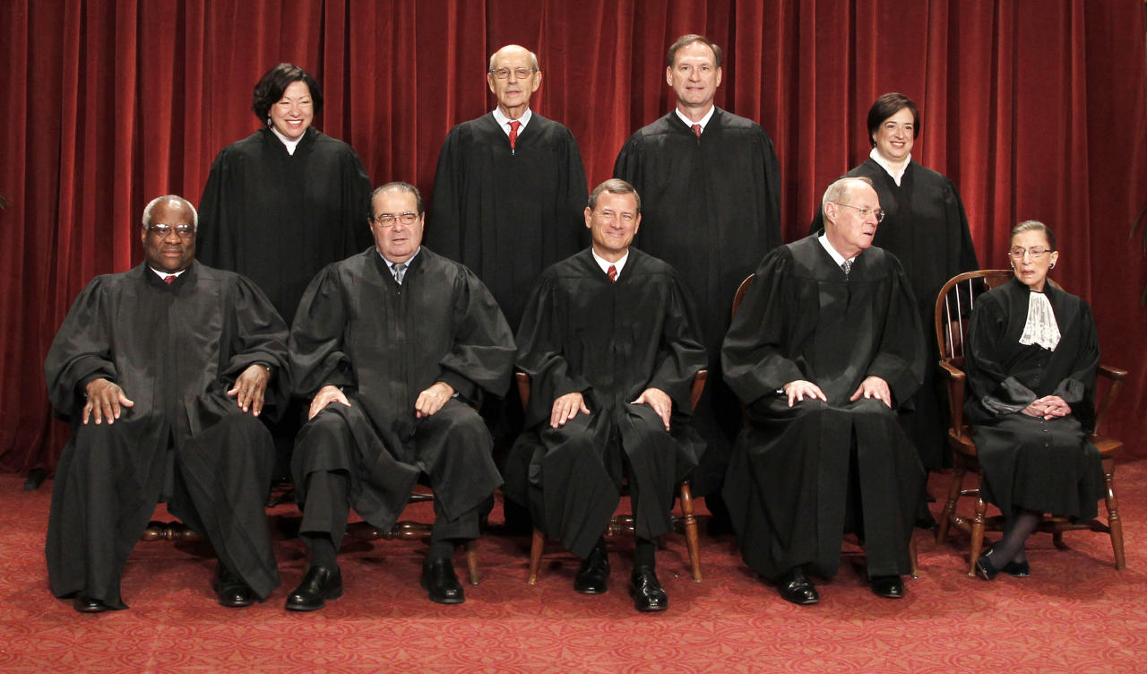 FILE - In this Oct. 8, 2010, file photo members of the U.S. Supreme Court gather for a group portrait at the Supreme Court in Washington. Seated from left are: Associate Justices Clarence Thomas, Antonin Scalia, Chief Justice John Roberts, Associate Justices Anthony M. Kennedy, and Ruth Bader Ginsburg. Standing, from left are: Associate Justices Sonia Sotomayor, Stephen Breyer, Samuel Alito Jr., and Elena Kagan. In an era when three women, a Hispanic and an African-American sit on the court and white men constitute a bare majority of the nine justices, the court is more diverse than the lawyers who argue before it. (AP Photo/Pablo Martinez Monsivais, File)