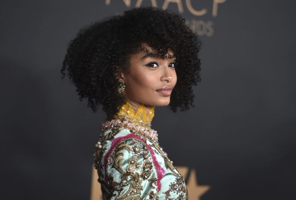 "FILE - Yara Shahidi arrives at the 51st NAACP Image Awards in Pasadena, Calif., on Feb. 22, 2020. Shahidi not only stars in the young adult dramedy ""grown-ish,"" but she also serves as an executive producer. The 21-year-old, who swaps out reading scripts for text books as a Harvard student, says she's equally invested in what happens behind the camera. (Photo by Richard Shotwell/Invision/AP, File)"