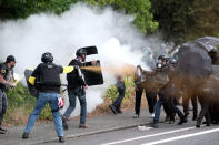 Members of the far-right group Proud Boys and anti-fascist protesters spray bear mace at each other during clashes between the politically opposed groups on Sunday, Aug. 22, 2021, in Portland, Ore. (AP Photo/Alex Milan Tracy)