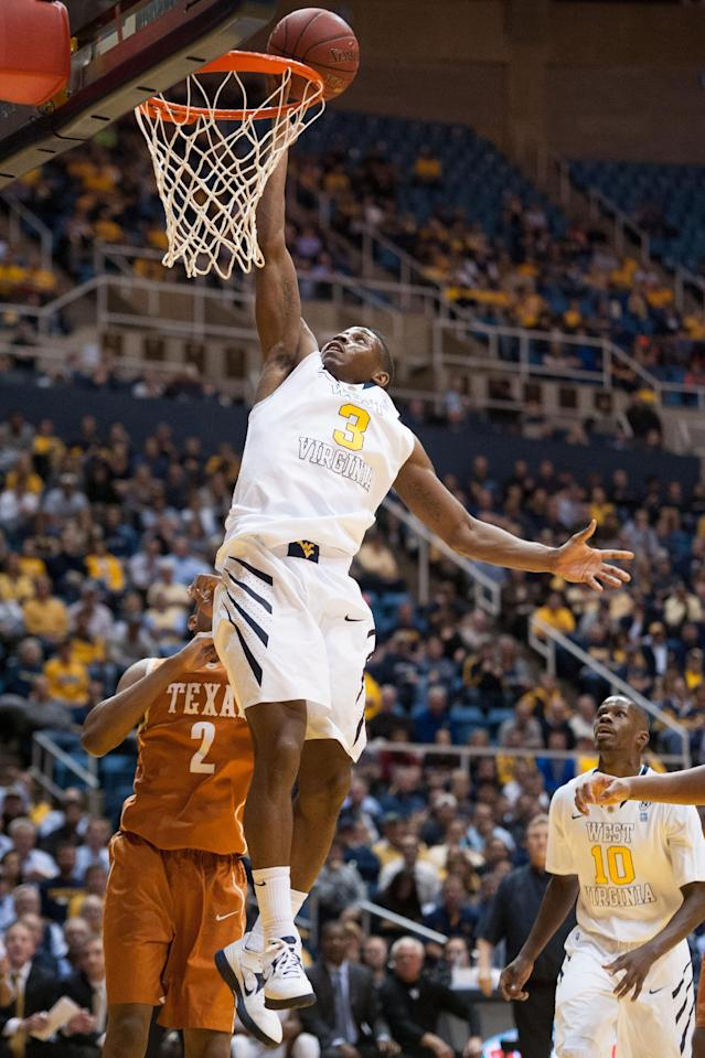 West Virginia's Juwan Staten (3) drives to the basket during the second half of an NCAA college basketball game, Monday, Jan. 13, 2014, in Morgantown, W.Va. Texas won 80-69. (AP Photo/Andrew Ferguson)