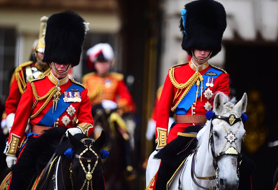 The Prince of Wales and the Duke of Cambridge make their way from Buckingham Palace to Horse Guards Parade, in London, ahead of the Trooping the Colour ceremony, as Queen Elizabeth II celebrates her official birthday.