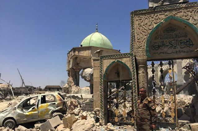 A Iraqi forces soldier stands outside the remains of the Great Mosque of al-Nuri, blown up weeks ago. (Ash Gallagher for Yahoo News)