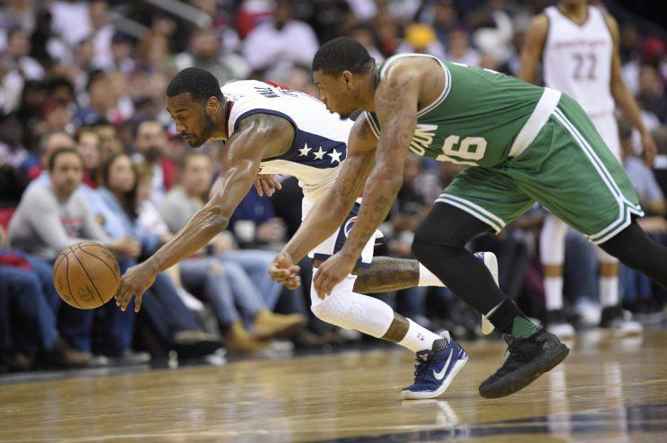 """<a class=""""link rapid-noclick-resp"""" href=""""/nba/players/4716/"""" data-ylk=""""slk:John Wall"""">John Wall</a> and the <a class=""""link rapid-noclick-resp"""" href=""""/nba/teams/was/"""" data-ylk=""""slk:Washington Wizards"""">Washington Wizards</a> were too much for the Celtics in the second half of Game 4. (AP)"""