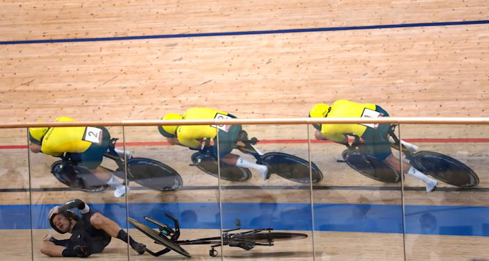 <p>(Top, from L) Australia's Sam Welsford, Australia's Lucas Plapp and Australia's Kelland O'Brien ride past New Zealand's Aaron Gate after he crashed during the men's track cycling team pursuit finals during the Tokyo 2020 Olympic Games at Izu Velodrome in Izu, Japan, on August 4, 2021. (Photo by Odd ANDERSEN / AFP) (Photo by ODD ANDERSEN/AFP via Getty Images)</p>