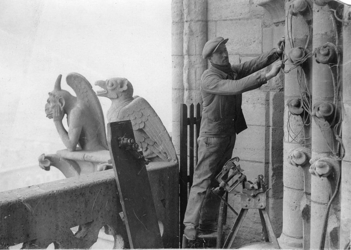 """<div class=""""inline-image__caption""""> <p>Installation works at the cathedral of Notre-Dame in Paris around 1900. </p> <br> <br> </div> <div class=""""inline-image__credit""""> Imagno/Getty </div>"""
